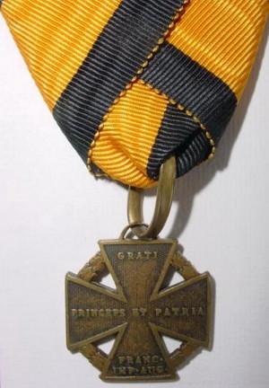 Rakouský Armádní kříž 1813/14 (Armeekreuz 1813/14), také zvaný dělový kříž. Foto sbírka VHÚ.
