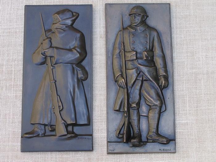 Restaurování bronzových reliéfů od Karla Babky