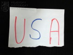 """Papírový útržek s nápisem """"USA"""", operace ISAF Afghánistán"""