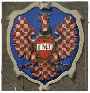Polepšený znak města Olomouce s prsním štítkem s iniciálami císaře Františka a královny Marie Terezie