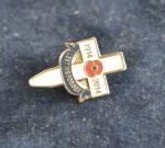 Klopové pamětní odznaky Dne válečných veteránů ve francouzském provedení a britský ve tvaru kříže