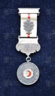 Turecká medaile Červeného půlměsíce, 2. stupeň – s dekorací za zásluhy v poli. Roky služby v horním ramínku neuvedeny (avers). FOTO VHÚ.