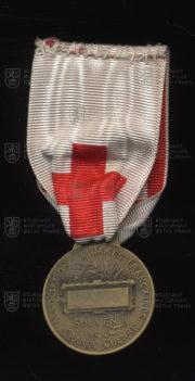 Francouzský pamětní odznak Společnosti francouzských dam (revers). FOTO VHÚ.